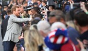 Princes Harry and William greet fans on eve of royal wedding