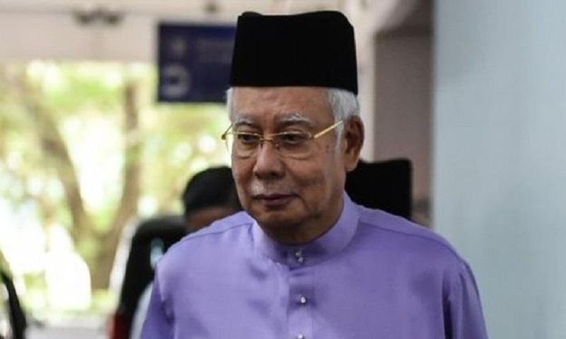 Najib Razak: Scandal-hit ex-Malaysia PM condemns police raids