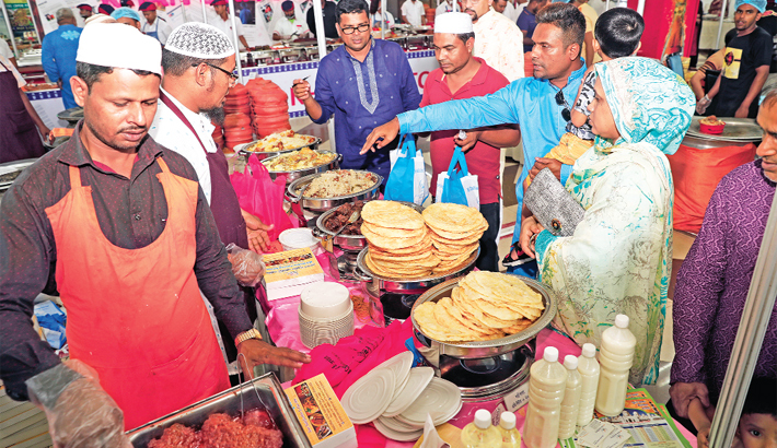 People throng a stall to buy mouth-watering iftar items
