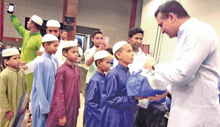 'Sayeman Beach Resort' Managing Director Mahboob Rahman distributes iftar
