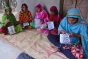 15000 Naogaon women become self-reliant weaving tupi