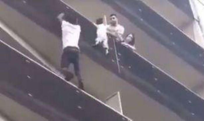 Real-life 'Spiderman' scales building to save child dangling from balcony (Video)