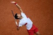 Djokovic reaches third round at Roland Garros