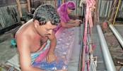 Weavers are busy weaving Jamdani sari