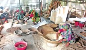 Women are busy preparing chemical-free puffed rice (muri)