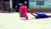 Woman drags 75-year-old mother-in-law on road in India (Video)