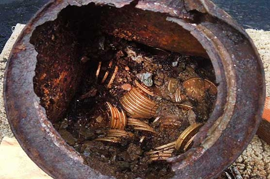 Demolition team finds pot of gold in abandoned house