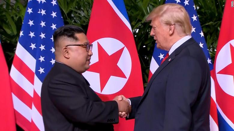 Trump, Kim share historic handshake, warm words