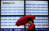 Asian markets lower after hawkish Fed, fresh trade war fears