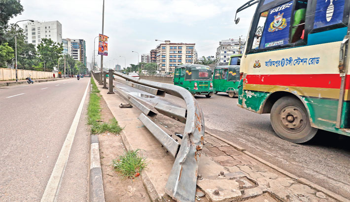 The railing of Mohakhali flyover lies damaged