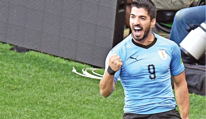 Luis Suarez celebrates after scoring against Saudi Arabia