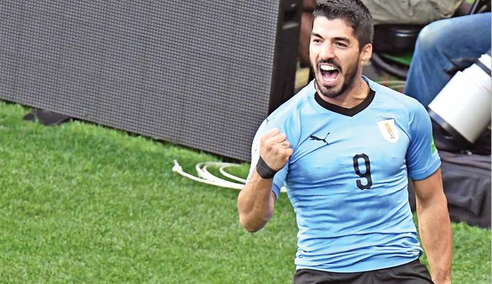 Luis Suarez celebrates after scoring against Saudi Arabia
