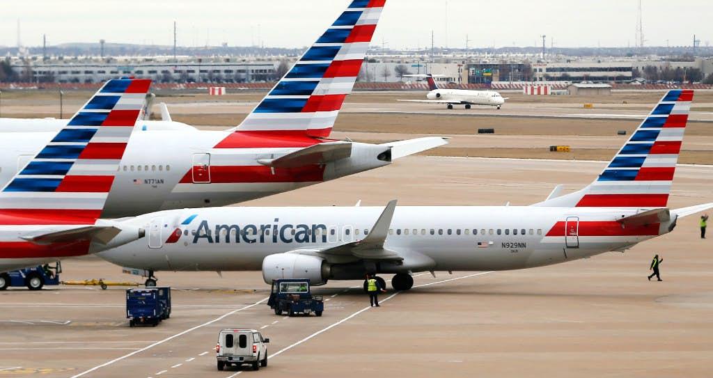 Woman breaks window in anger over flight cancelations