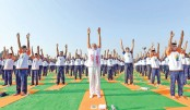 Int'l Yoga Day stretches around world