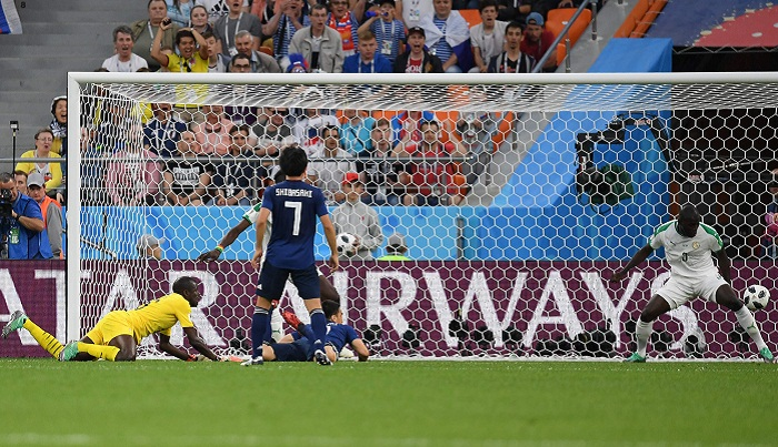 Japan hold Senegal 2-2 draw keeping last-16 hopes alive