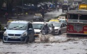 Four dead in 24 hours as heavy rain pounds Mumbai; traffic, trains hit