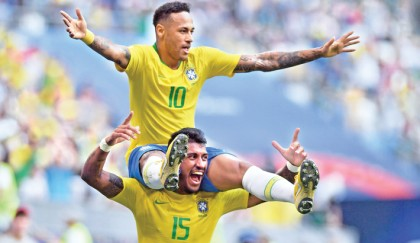 Brazil storm into quarters