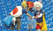 Japan fans stay back to clean stadium after defeat