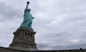Statue of Liberty climber in custody after forcing evacuation