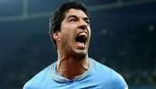 After the hand and the bite, Suarez gets his head right