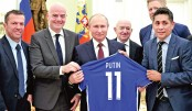FIFA tells Putin world is  'in love' with Russia