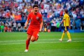 Maguire puts England ahead against Sweden
