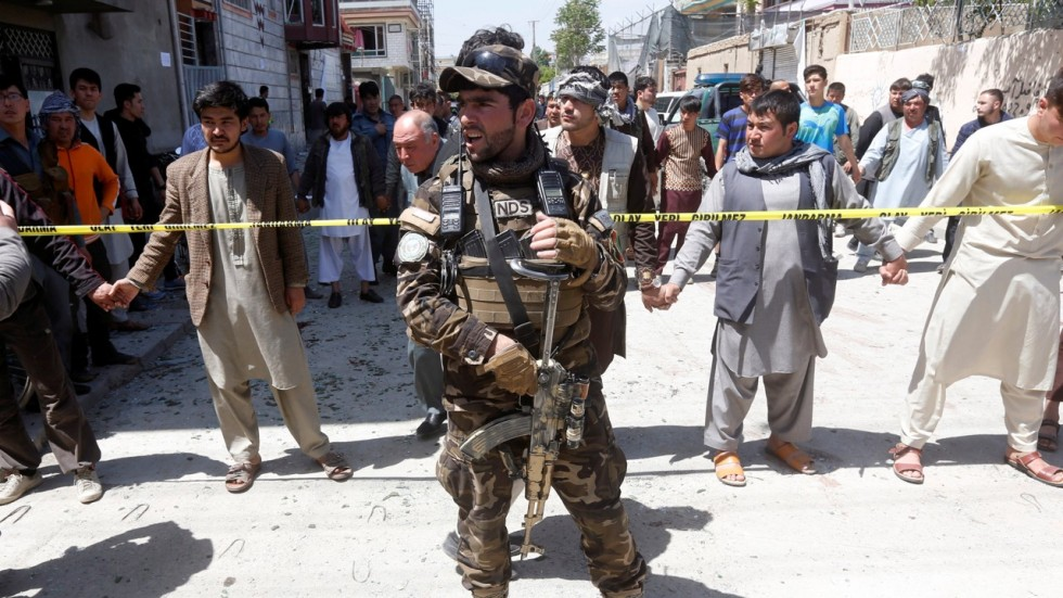 Attackers in eastern Afghanistan storm building, kill 10