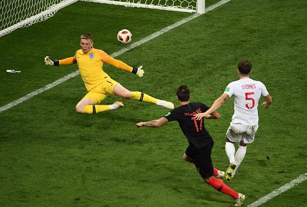 Image result for Juventus striker Mario Mandzukic scored the winning goal in the 109th minute, slotting in from Ivan Perisic's flick-on into the area.