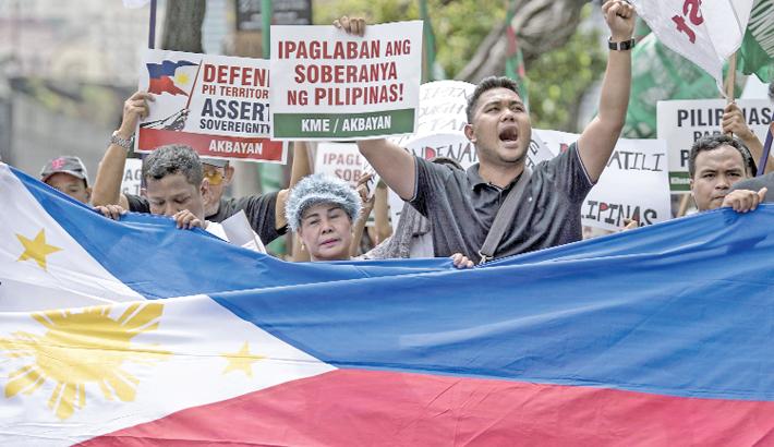 Activists participate on a protest