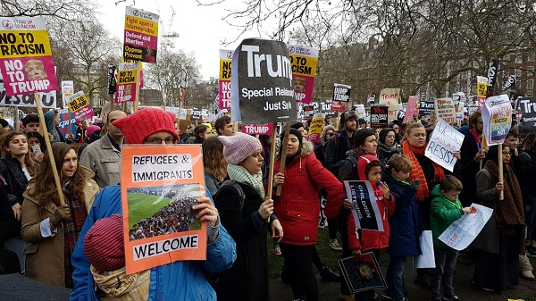 Tens of thousands march through London in anti-Trump protests