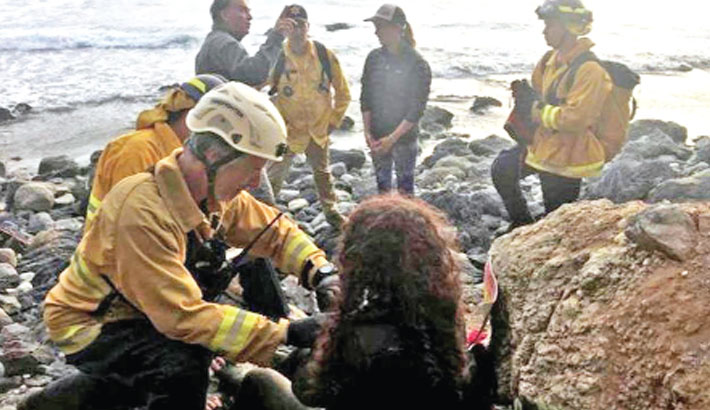 Woman rescued a week after cliff plunge