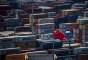 Asian markets turn negative as data shows China growth slowing