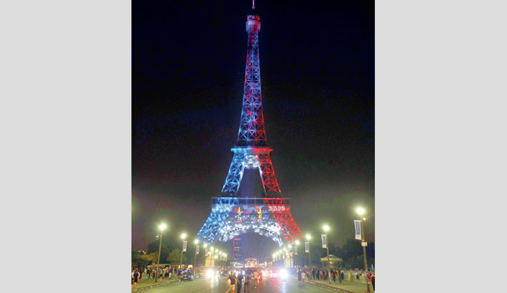 The Eiffel Tower is illuminated