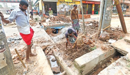 Road, drainage repair work goes on at snail's pace