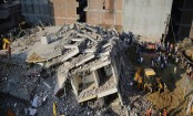 Building collapses into another near Indian capital, 3 die