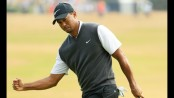 Woods creates buzz at Carnoustie with 66 at British Open