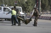 Blast in Afghanistan's Kabul kills 14, returning vice president unharmed