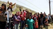 Hundreds of Syrian refugees return home from Lebanon