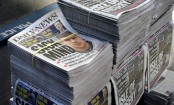New York tabloid axes half of its staff