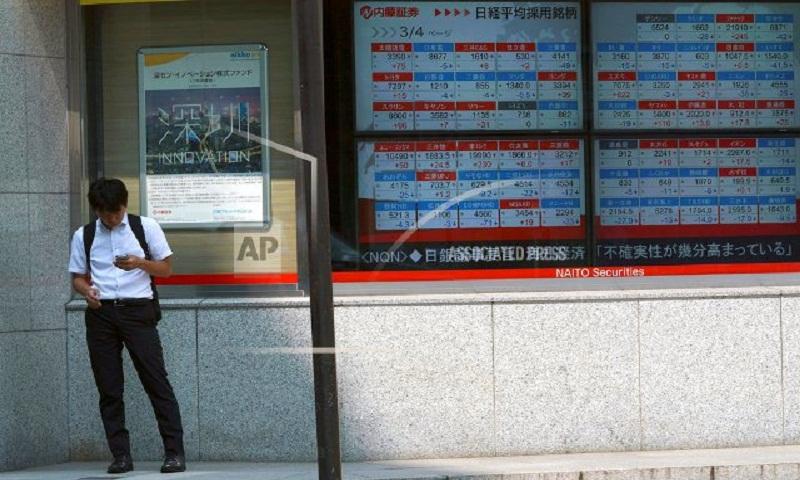 Asian markets flat after Apple value surpasses $1 trillion