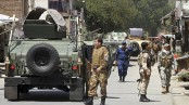 At least 100 security forces killed in fight for Afghan city: minister