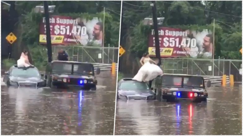 Cops rescue bride stranded on top of car in flood water (Video)
