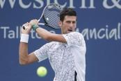Djokovic wins in Cincinnati, Halep's match suspended