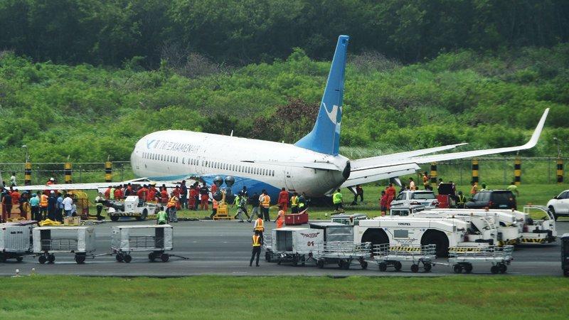 Chinese plane slides off Manila airport runway in heavy rain