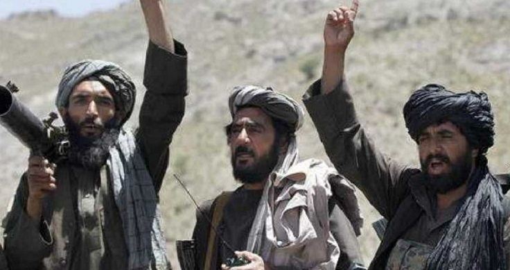 Afghan officials: Taliban take at least 100 people hostage
