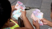 Venezuela 'paralysed' by launch of sovereign bolivar currency