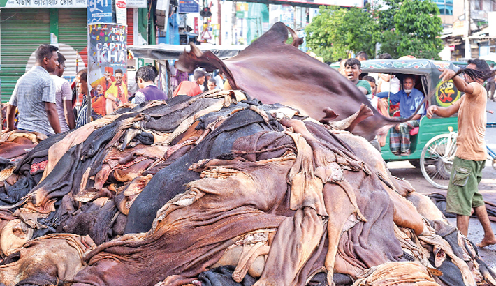 Workers pile up rawhide of sacrificial animals