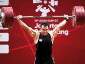 Iranian weightlifter sets eternal record in Asian Games