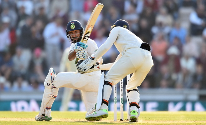 Pujara's ton-up gives India a narrow lead in fourth Test