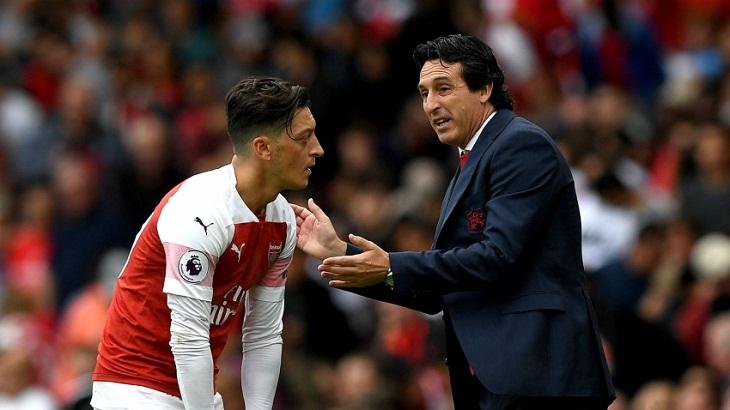 Ozil back for Arsenal after rift talk